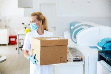 lab-assistant-carrying-box-with-vaccines-covid-19-laboratory